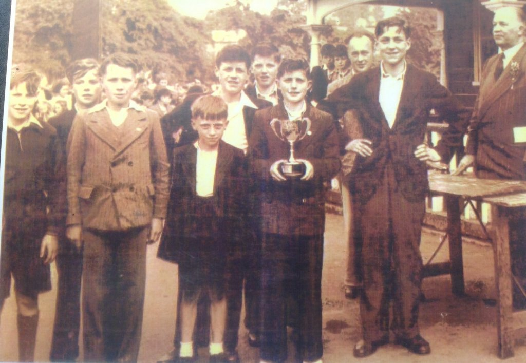 1956: The Darkley winning team at Armagh Sports. Vincent O Connor, John Crowe, Pat Farrell, Jim Loughran, Sam Flanagan, Neville Cornett, F. Mc Gaughey and Jim Mc Nally with Master Mc Call behind (Principal 1950-1980)